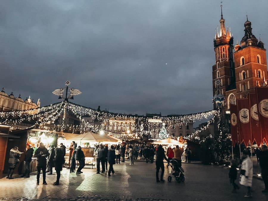 Old Town Square and Sukiennice in Krakow, Poland at night.