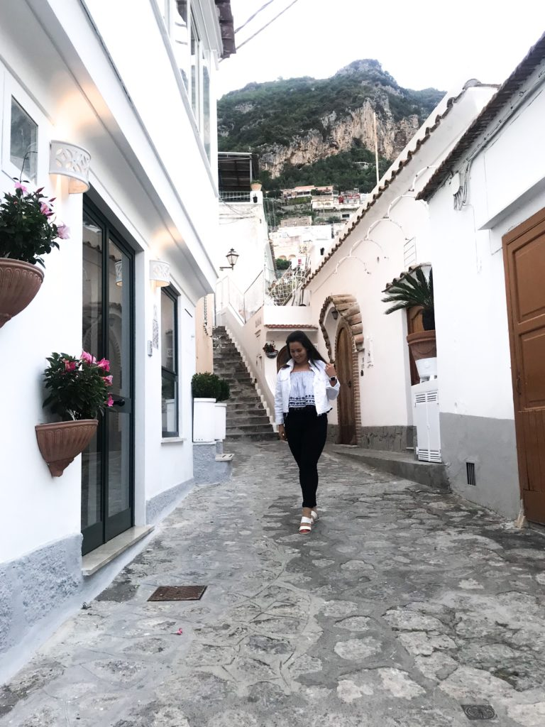 Travel blogger traveling alone in Positano, Amalfi Coast, Italy.
