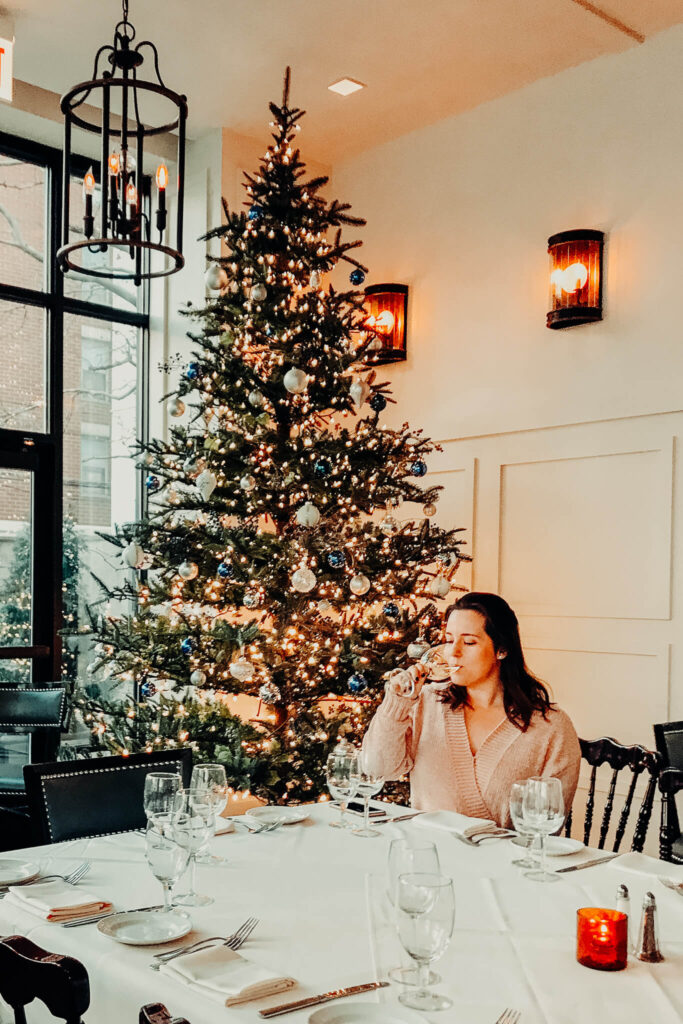 Sipping wine by a Christmas tree in Chicago, Illinois